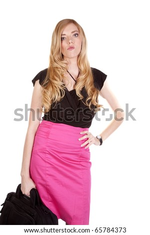 a business woman l with a mad expression on her face while she is carrying her bag. - stock photo