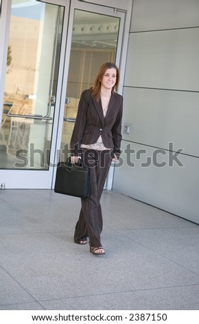 A business woman leaving the office for the day - stock photo