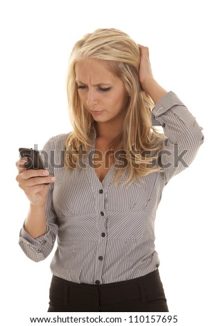 A business woman looking at her phone with a confused expression. - stock photo