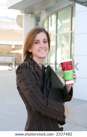 A business woman on a coffee break - stock photo