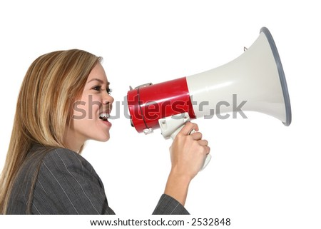 A business woman shouting into a megaphone - stock photo