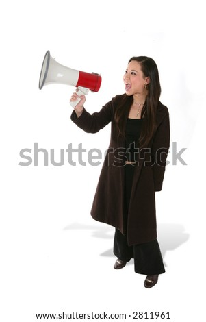 A business woman shouting into a megaphone