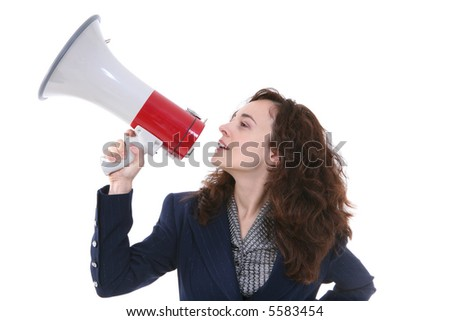 A business woman speaking into a megaphone - stock photo