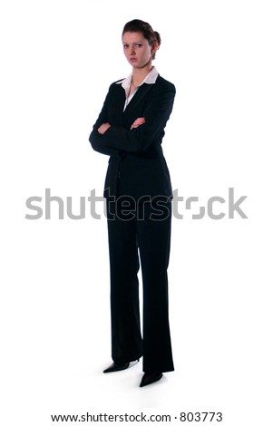 A business woman standing with her arms crossed. (serious) - stock photo