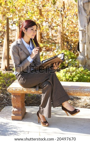 A business woman thinking out of the office