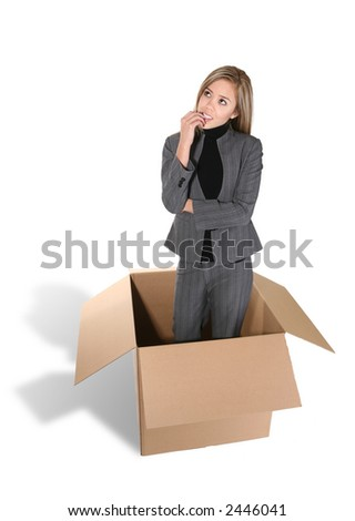 A business woman thinking outside the box - stock photo