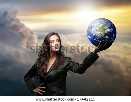a business woman with a globe - stock photo