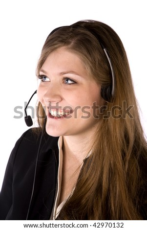 A business woman with headset on talking with a smile on her face. - stock photo