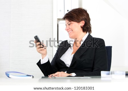 A business woman working on a tablet - stock photo