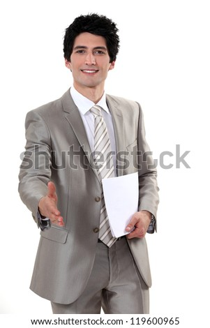 A businessman about to shake hands. - stock photo