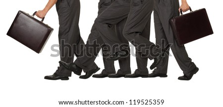 A businessman advances one step forward representing success on white - stock photo