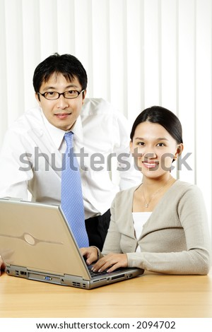A businessman and a businesswoman in an office