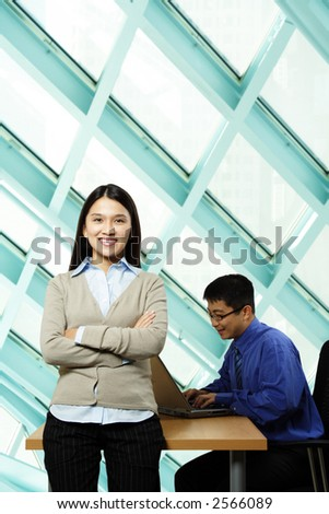 A businessman and a businesswoman working together in an office