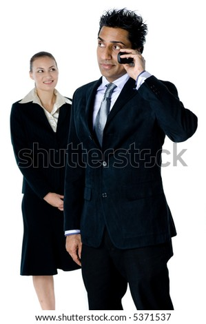 A businessman and his female colleague using phones on white background