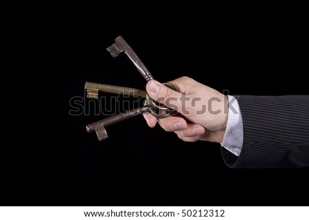 A businessman asking to someone to choose a key - stock photo
