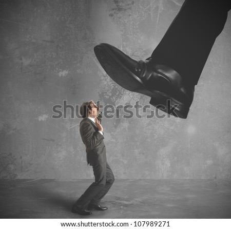 A businessman burdened by heavy taxes - stock photo