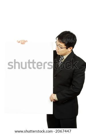 A businessman carrying a blank display card - stock photo