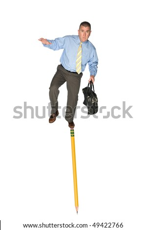 A businessman carrying a briefcase balances himself on the eraser of a pencil.  Good for skill, challenge or adversity business inferences. - stock photo