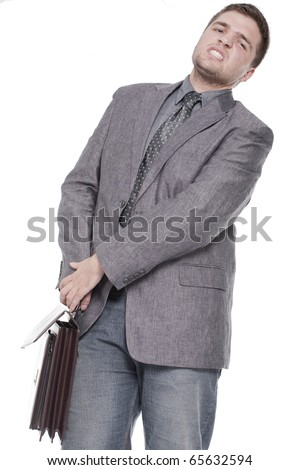 a businessman carrying a heavy briefcase