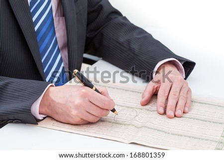 A businessman checking and marking exchange differences