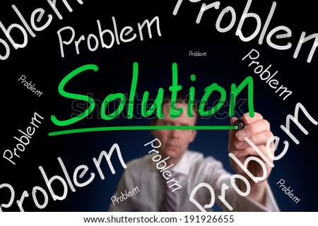A businessman drawing a, no matter how big or small the problem is there's always a solution. - stock photo