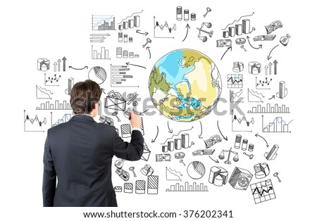 A businessman drawing the Earth in colour surrounded by different graphs and diagrams. Back view. White background. Concept of thinking about the planet. - stock photo