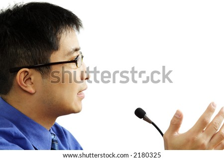 A businessman giving a speech (isolated white) - stock photo