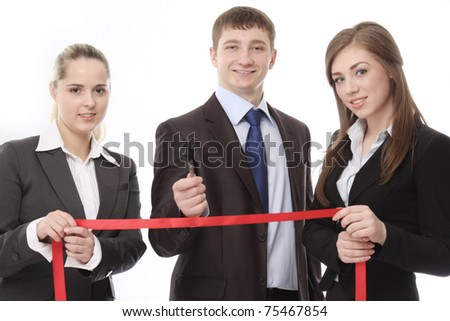 A businessman giving scissors to cut the red ribbon - stock photo