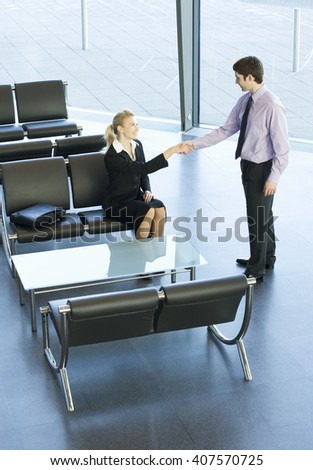 A businessman greeting a client or job candidate - stock photo
