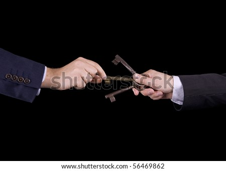 A businessman hand picking the golden key - stock photo