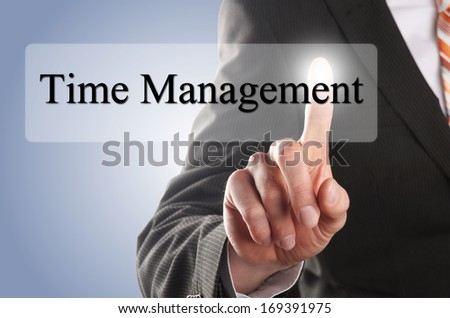 a businessman hand press the time management button - stock photo