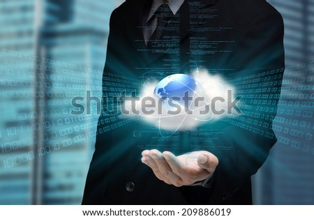 A businessman hand showing the concept  of cloud computing internet technology in his hand - stock photo