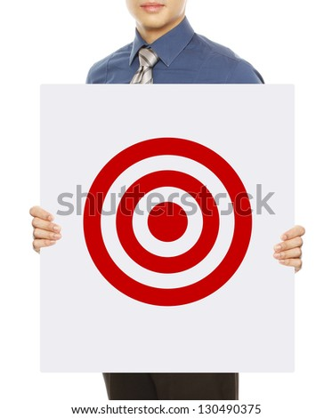 A businessman holding a signboard with a generic target symbol - stock photo