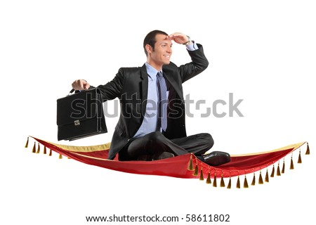 A businessman holding a suitcase while flying on a magic carpet - stock photo