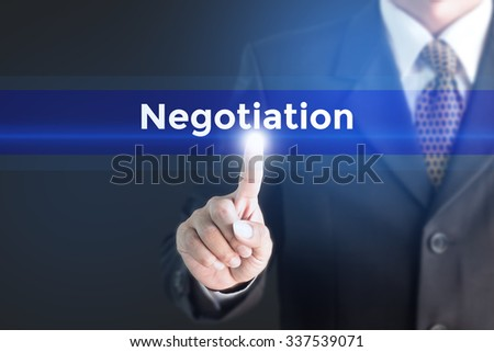 A Businessman holding a white sign with the message Negotiation. Can bring to the medium of your ad. - stock photo