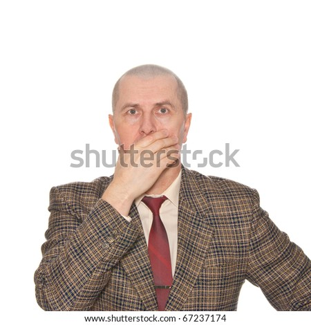 A businessman holding his hand over his mouth. Isolated on white. Body language. Manifest of telling untruth. - stock photo