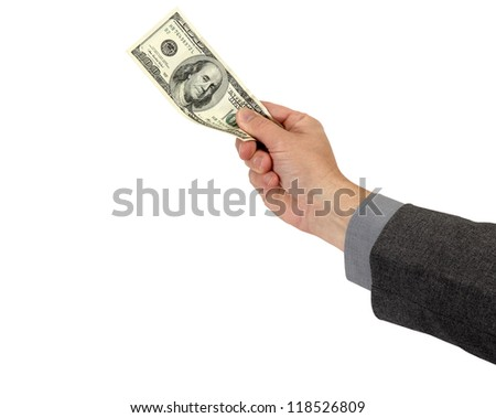 A businessman holds his profit or wages isolated on white