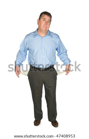 A businessman holds out his empty pockets showing that he is broke and has no cash. - stock photo