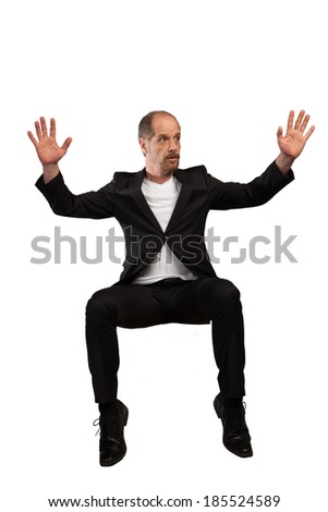 A Businessman in a free fall position isolated on a white background. - stock photo