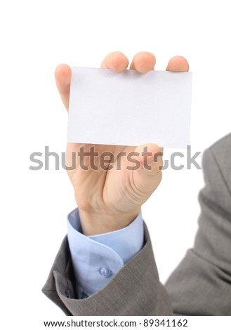 A businessman in a grey suit and a blue shirt shows, professional business card with a copy of the space, small-scale department of the field. Isolated on a white background.