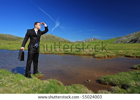 A businessman in a suit searching for a way - stock photo