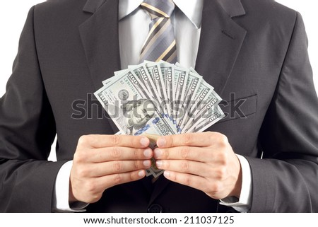A businessman in a suit showing new hundred dollar bills
