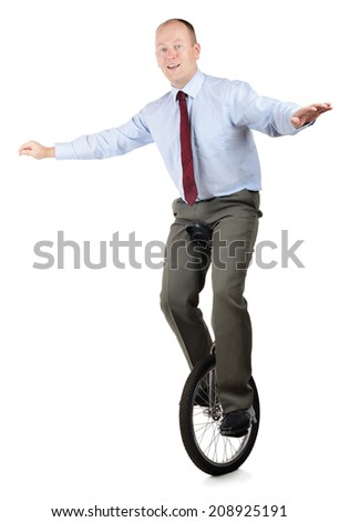 A businessman in a unicycle demonstrating skill and performance