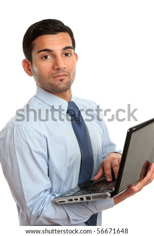 A businessman in blue pinstripe shirt holding a laptop computer.   White background. - stock photo