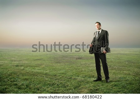 A businessman in the countryside - stock photo
