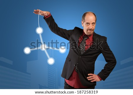 A Businessman is moving a virtual network with his fingers. - stock photo