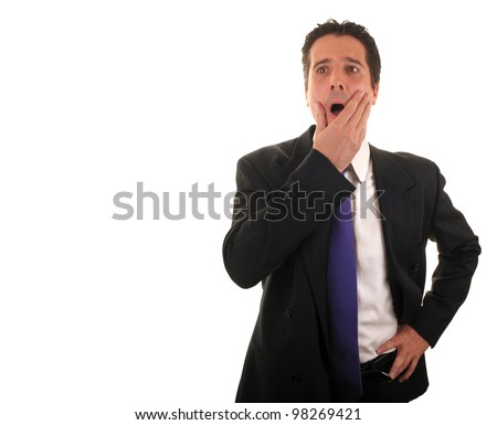 A businessman is under stress as he ponders his financial future. - stock photo