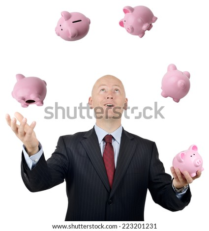 A businessman juggling money concept isolated on a white background - stock photo