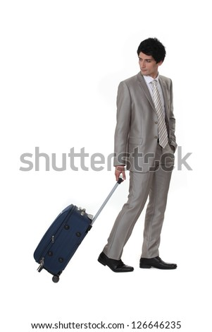 A businessman leaving on a business trip - stock photo