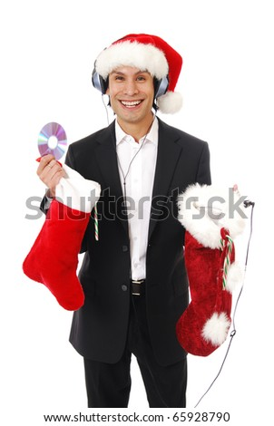A businessman listening to Christmas music